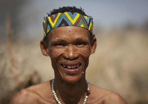San Man With The Face Spattered With The Pulp Of The Water Tuber, Namibia