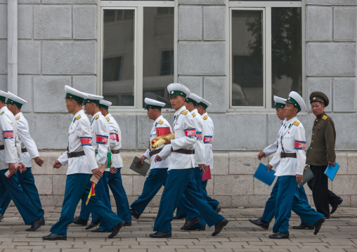 Group of North Korean male traffic security officers in white uniforms in the street, Pyongan Province, Pyongyang, North Korea
