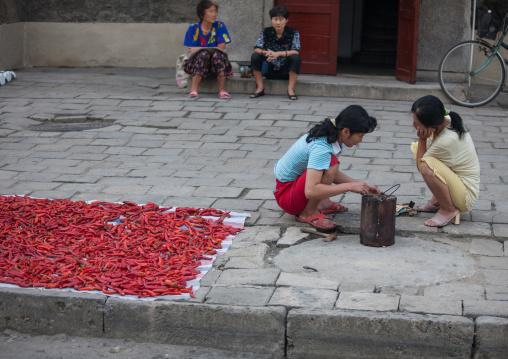 North Korean women sit near dried kimchi, Pyongan Province, Pyongyang, North Korea