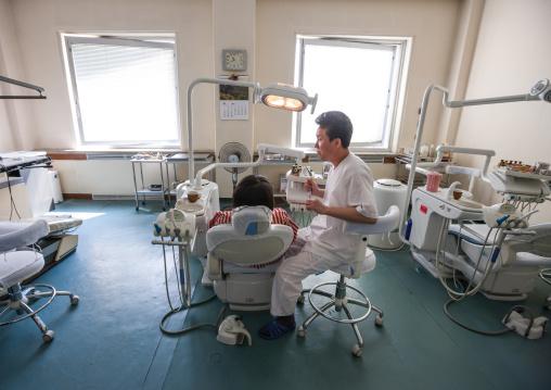 North Korean dentist and his patient in an hospital, Pyongan Province, Pyongyang, North Korea