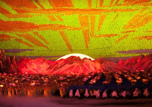 Rising sun over mount Paektu made by children pixels holding up colored boards during Arirang mass games in may day stadium, Pyongan Province, Pyongyang, North Korea