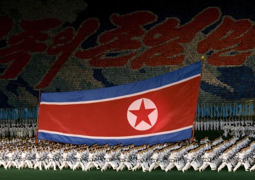 North Korean taekwondo team in front of a giant flag during the Arirang mass games in may day stadium, Pyongan Province, Pyongyang, North Korea