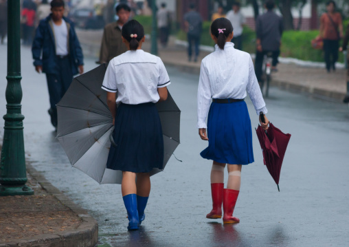 North Korean girls in the street during a rainy day, North Hwanghae Province, Sariwon, North Korea