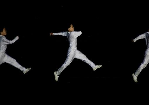 North Korean gymnasts jumping during the Arirang mass games in may day stadium, Pyongan Province, Pyongyang, North Korea