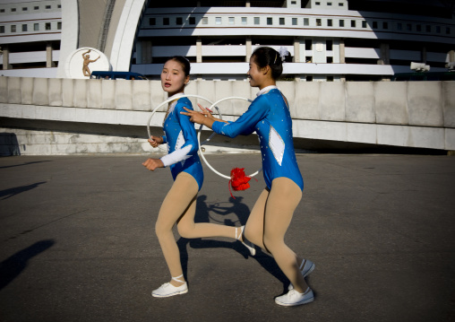 North Korean gymnasts going to the Arirang mass games outside of may day stadium