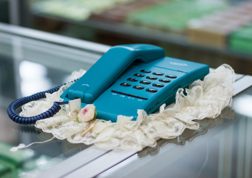 An old blue fashioned telephone on a dresser in Yanggakdo international hotel, Pyongan Province, Pyongyang, North Korea