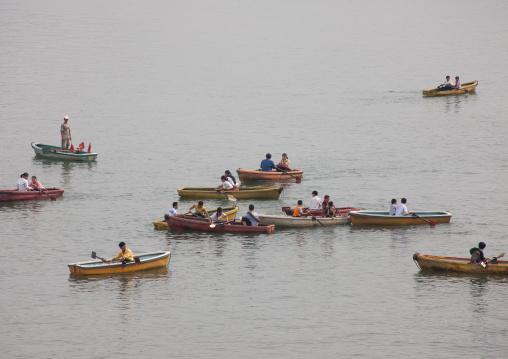 North Korean people paddling on small boats on Taedong river, Pyongan Province, Pyongyang, North Korea