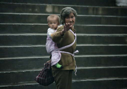 North Korean woman carrying a baby on her back, South Hamgyong Province, Hamhung, North Korea