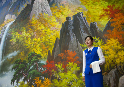 North Korean waitress in front of nature painting in a restaurant, South Hamgyong Province, Hamhung, North Korea