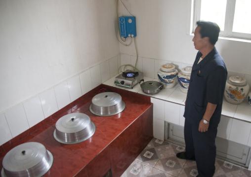 North Korean man using methane gas in his kitchen, South Hamgyong Province, Hamhung, North Korea