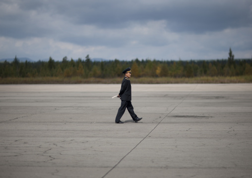 North Korean employee walking on runway Samjiyon airport, Ryanggang Province, Samjiyon, North Korea