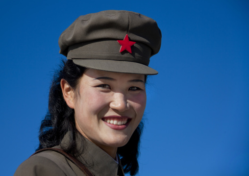 North Korean female guide smiling wearing cap with red star, Ryanggang Province, Samjiyon, North Korea