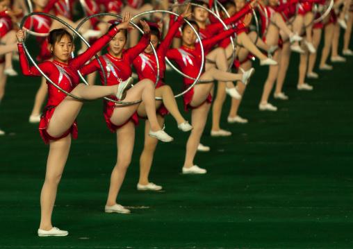 North Korean gymnasts performing with hoops at Arirang mass games in may day stadium, Pyongan Province, Pyongyang, North Korea