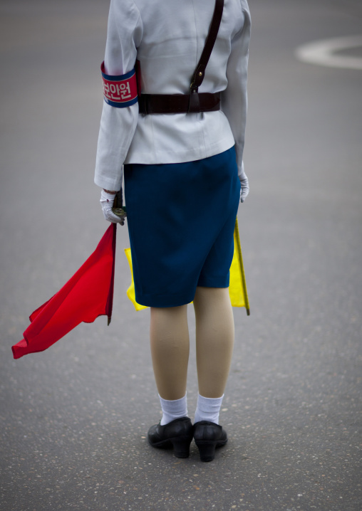 North Korean female traffic security officer in white uniform in the street, Pyongan Province, Pyongyang, North Korea