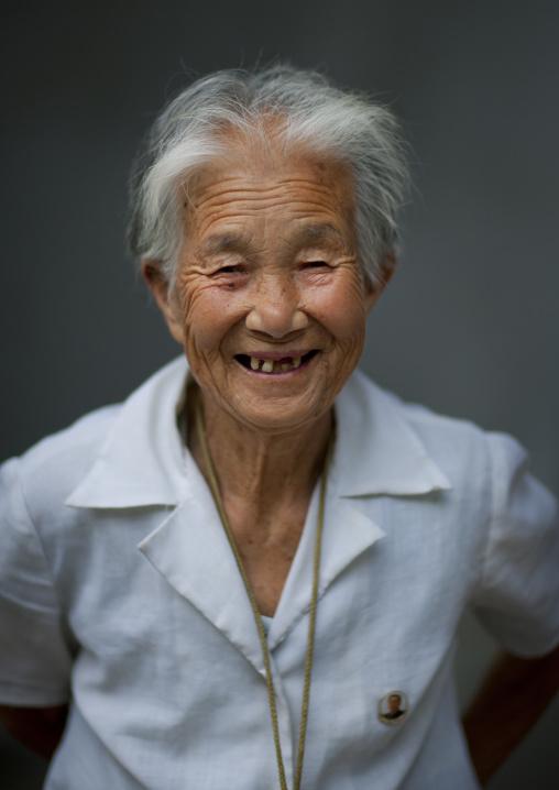 North Korean elderly woman smiling with toothless grin, Pyongan Province, Pyongyang, North Korea