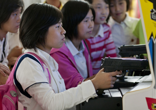 North Korean girls playing video game with gun at kaesong youth park, Pyongan Province, Pyongyang, North Korea