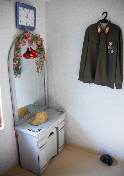 Military jacket hung in a North Korean house, Kangwon Province, Chonsam, North Korea