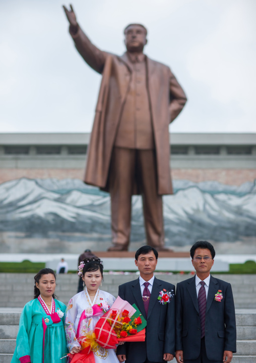 North Korean couples celebrating their wedding in front of Kim il Sung statue in Mansudae Grand monument, Pyongan Province, Pyongyang, North Korea