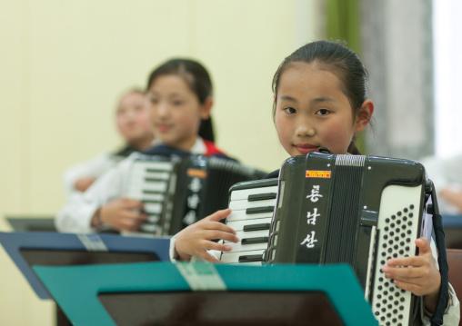 Accordion classroom with North Korean students in Mangyongdae children's palace, Pyongan Province, Pyongyang, North Korea