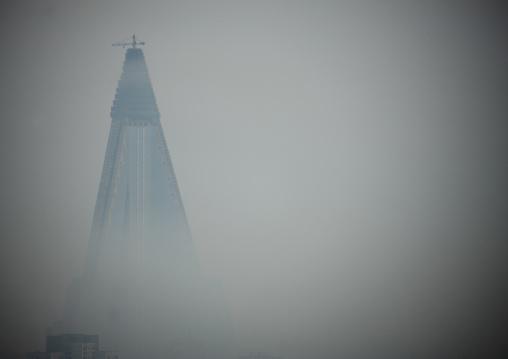 The pyramid-shaped Ryugyong hotel in the fog, Pyongan Province, Pyongyang, North Korea
