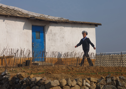 North Korean navy sailor in front of a house in the countryside, South Pyongan Province, Nampo, North Korea