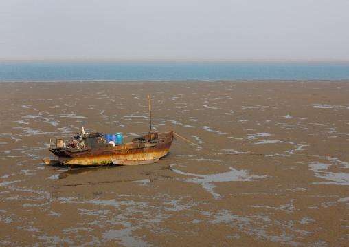 North Korean fishermen boat at low tide, South Pyongan Province, Nampo, North Korea