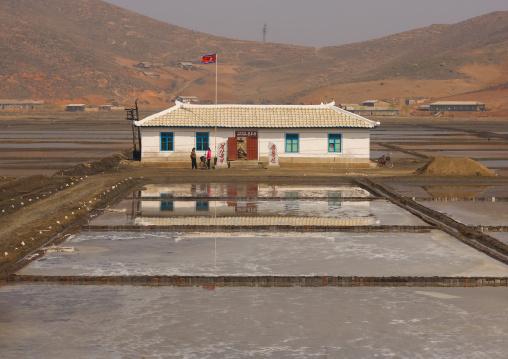 Traditional salt ponds i front of a house, South Pyongan Province, Nampo, North Korea