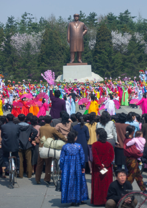 North Korean women dancing in front of Kim il Sung statue in a village, South Pyongan Province, Nampo, North Korea