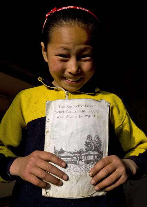 North Korean girl holding an english class book, Kangwon Province, Chonsam Cooperative Farm, North Korea
