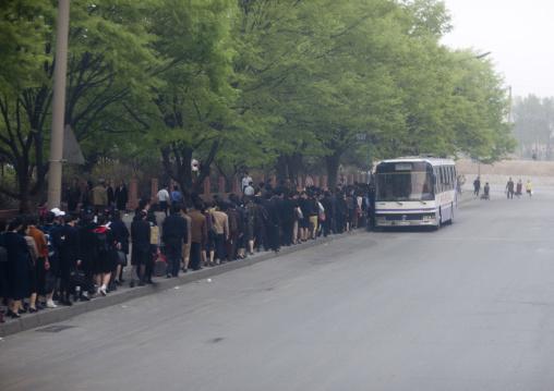 North Korean people queueing in the street to take a bus, Pyongan Province, Pyongyang, North Korea