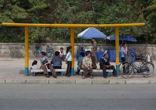 North Korean people waiting for a bus in the street, South Hamgyong Province, Hamhung, North Korea