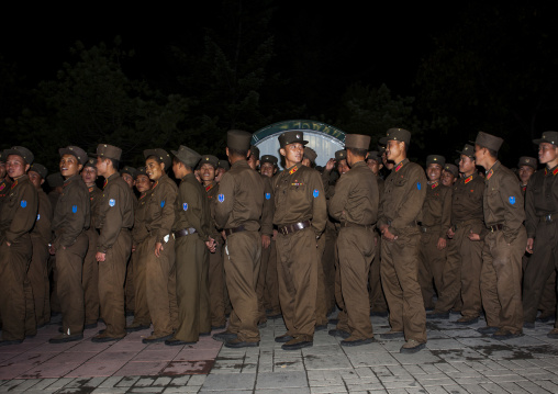 North Korean soldiers queueing for a fairground attraction at Kaeson youth park, Pyongan Province, Pyongyang, North Korea