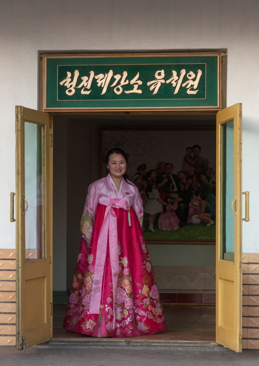 Portrait of a North Korean woman in traditional choson-ot in the entrance of a school, North Hamgyong Province, Chongjin, North Korea