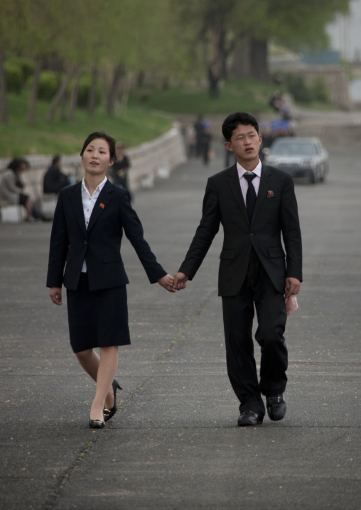 North Korean couple inlove walking hand in hand in the street, Pyongan Province, Pyongyang, North Korea