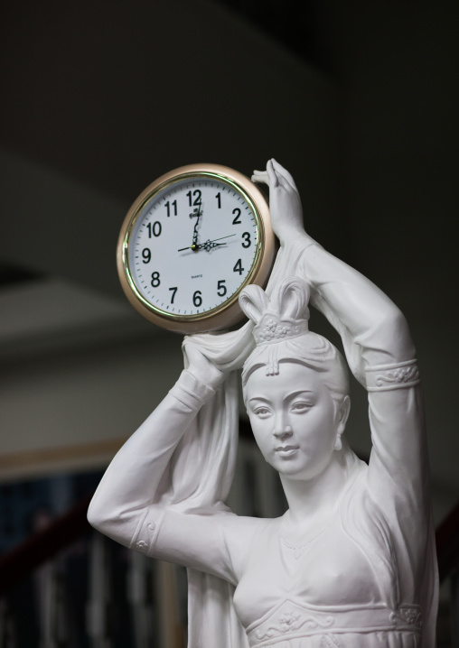 Statue of a woman holding a clock, Pyongan Province, Pyongyang, North Korea