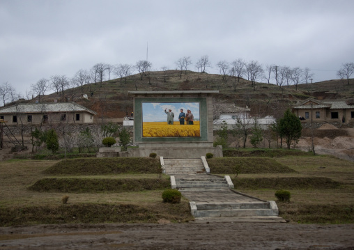 Propaganda fresco depicting the Dear Leaders in a field, North Hwanghae Province, Kaesong, North Korea