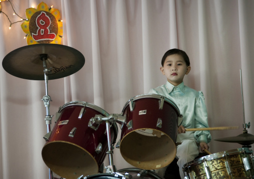 Young North Korean boy playing drums in Kwangbok school, Pyongan Province, Pyongyang, North Korea