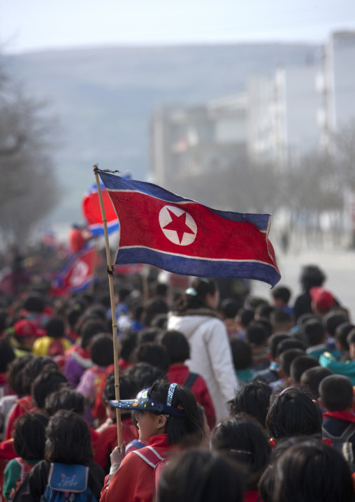 North Korean children parading in the streets on the international workers' day with the national flag, Kangwon Province, Wonsan, North Korea