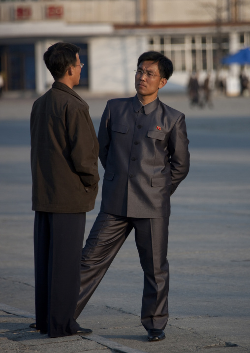 North Korean men dressing with vinylon suits chatting in the street, Kangwon Province, Wonsan, North Korea