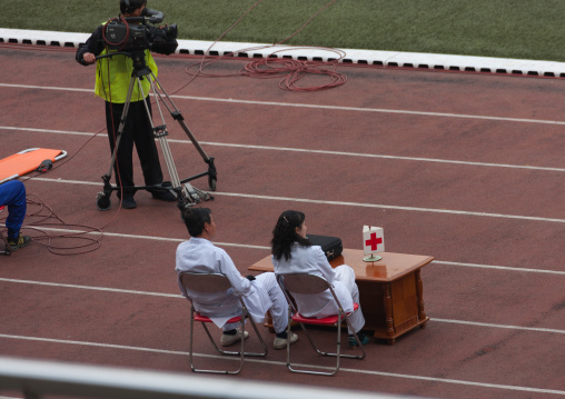 Medical staff in Kim il Sung stadium during a football game, Pyongan Province, Pyongyang, North Korea