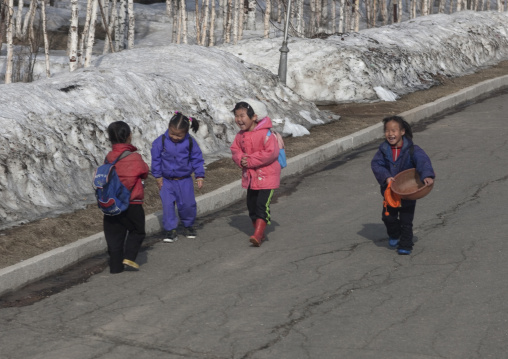 North Korean children going to school in a snowy road, Ryanggang Province, Samjiyon, North Korea