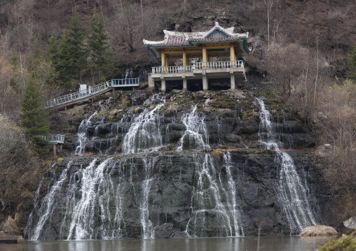 Pavillon over rimyonsu waterfalls in autumn, Ryanggang Province, Samjiyon, North Korea