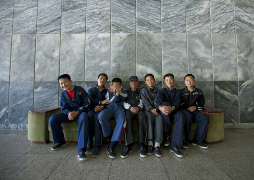 Group of North Korean boys sitting and laughing on a bench at the Songdowon international children's camp, Kangwon Province, Wonsan, North Korea