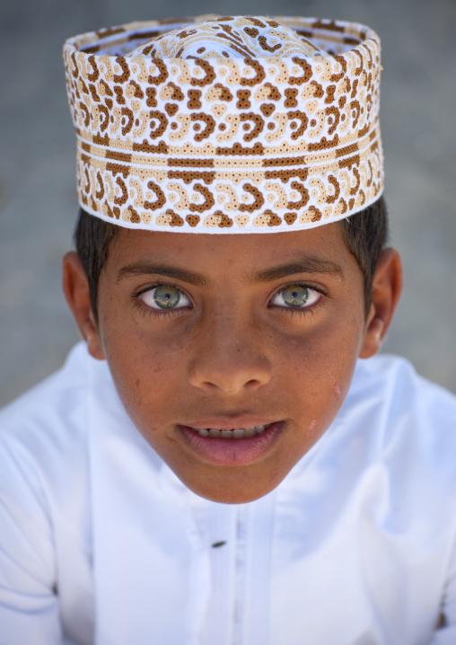 Green Eyed Boy Wearing Cap In Masirah Island, Oman