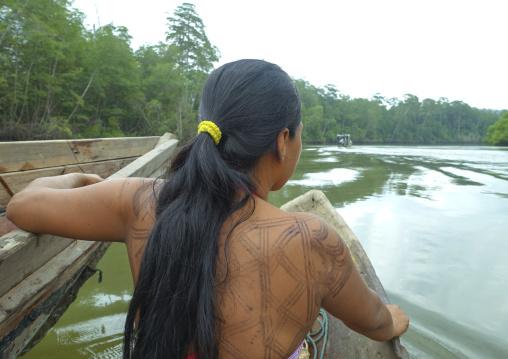 Panama, Darien Province, Puerta Lara, Wounaan Tribe Woman Going To Fish In A Canoe