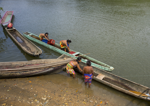 Panama, Darien Province, Puerta Lara, Indigenous Wounaan Women Set Out To Go Fishing In Their Boats