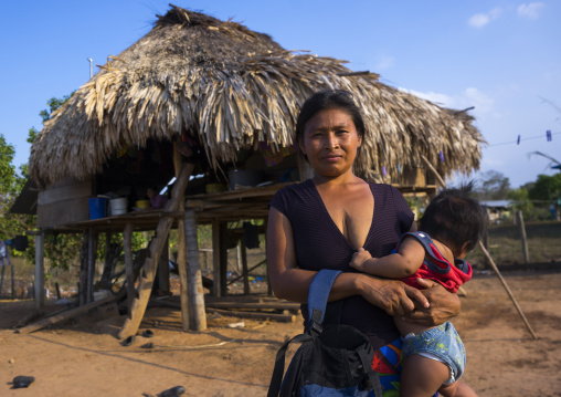 Panama, Darien Province, Alto Playona, Woman Of The Native Indian Embera Tribe With Her Baby
