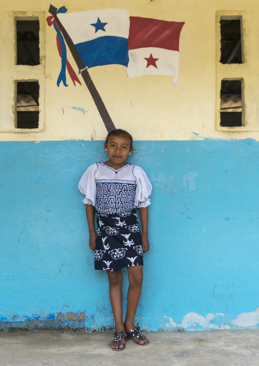 Panama, San Blas Islands, Mamitupu, Kuna Girl In A School In Front Of A Painting Of The Panama Flag
