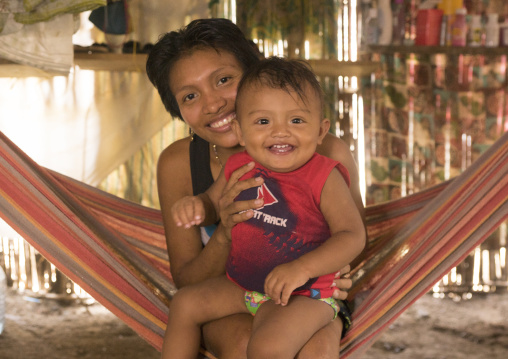 Panama, San Blas Islands, Mamitupu, Portrait Of A Smiling Kuna Tribe Mother With Her Baby In A Hammock