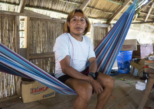 Panama, San Blas Islands, Mamitupu, Gay Kuna Indigenous Man Sitting In A Hammock